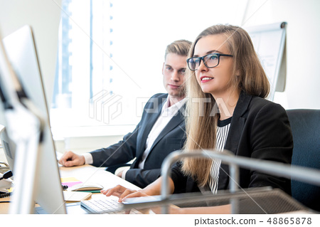 Businesswoman working on computer at the office 48865878