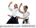 Man and woman fighting at Aikido training in martial arts school. 48868082