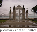 A fence with high columns and gate in the palace 48868821