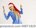 Christmas woman holding bell. 48871829