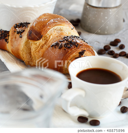 Breakfast with coffee and croissant 48875896
