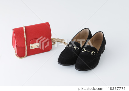 Party goods red bag and black loaf on white background 48887773