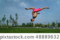 Tricking on lawn in park 48889632