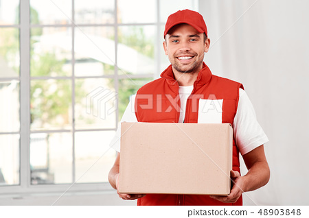 People expect good service but few are willing to give it. Image of a happy young delivery man 48903848