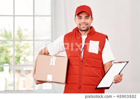 Customers loves certainty, make sure you give it to them. Image of a happy young delivery man 48903882