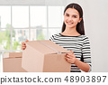 The customer s perception is your reality. Young woman preparing parcels for shipment to client in 48903897