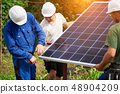 Installation of stand-alone exterior photo voltaic panels system. Renewable green energy generation. 48904209