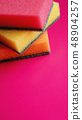 Household cleaning concept. Colorful sponges on pink background 48904257