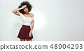 Can i go home? Tired young afro american woman feeling headache and holding a hand on her head while 48904293