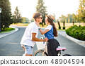 Young couple hugging on road on sunset. Pretty 48904594