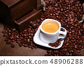 Fresh roasted coffee beans in burlap sack, espresso in cup and grinder on stone background. 48906288
