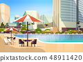 luxury city hotel swimming pool resort with umbrellas desks and chairs restaurant furniture around 48911420