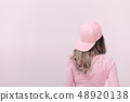 beautiful woman in white t-shirt with pink skateboard 48920138
