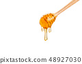 honey dripping down from wooden honey dipper, on 48927030