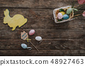 Easter decoration with eggs on wooden table 48927463