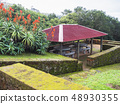 Alcove porch with seating flower garden at viewpoint at Maia village, Sao Miguel island, Azores 48930355