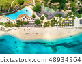 Aerial view of tropical sandy beach with palms and 48934564