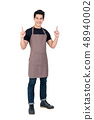 Young handsome Asian barista pointing up in studio 48940002