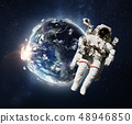 Flying astronaut operating nearby of planet Earth. 48946850