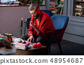 Bearded fortune-teller having some difficulties while working at home 48954687