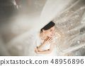 Portrait of beautiful bride with fashion veil at wedding morning 48956896