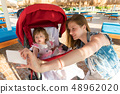 Mother taking selfie with baby on resort 48962020