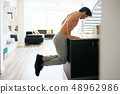 Man Training Chest Doing Low Chest Push-Ups On Kitchen Counter 48962986