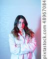 Portrait of beautiful female scientist in neon light 48967084