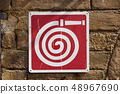 Fire hose wall sigh flat material design on the brick wall 48967690