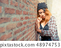 Depressed teenage woman feeling sad and lonely. 48974753