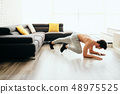 Adult Man Training ABS and Legs Doing Mountain Climbing Plank 48975525