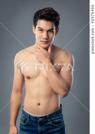 Portrait of shirtless young handsome Asian man 48976466