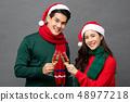 Asian couple drinking champagne celebrating 48977218