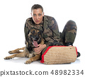 woman soldier and malinois 48982334