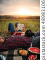 Love couple resting together, picnic in the field 48983106