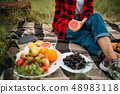 Woman with fruits, picnic in summer field 48983118