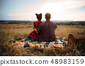 Love couple sitting on plaid, back view 48983159