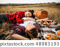 Love couple lies on plaid, picnic in summer field 48983193
