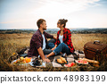 Happy love couple on picnic in summer field 48983199