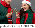 Asian couple drinking champagne celebrating 48984292