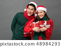 Asian couple wearing colorful red and green 48984293