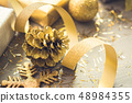 Gold glittered christmas decorations 48984355