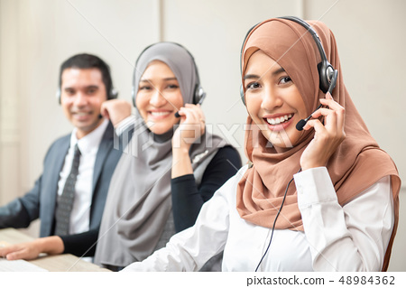 Smiling Asian muslim women working  in call center 48984362