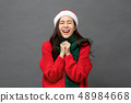 Excited woman in red Christmas sweater 48984668