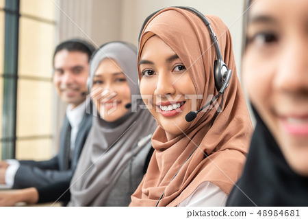 Smiling Asian muslim women working  in call center 48984681