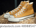 closeup of yellow sneakers in fashion store 48988547