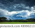 Image of dark Storm clouds over the forest 48990213