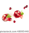 Overhead photo of vibrant red drink with berries on white 48995446