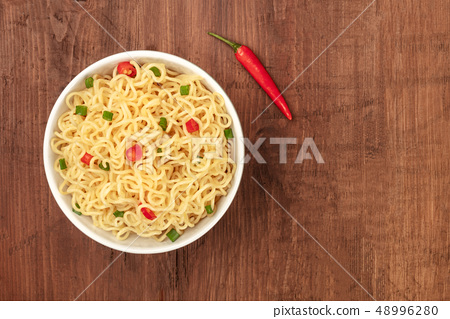 Overhead photo of noodles with a chili pepper and copy space 48996280