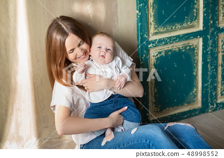 Happy Mothers Day. Adorable happy woman with baby 48998552